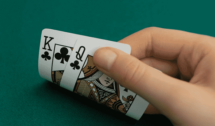 how to play king queen suited in cash games preflop and postflop